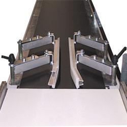 Guidage latéral sur portillon à rouleaux motorisés